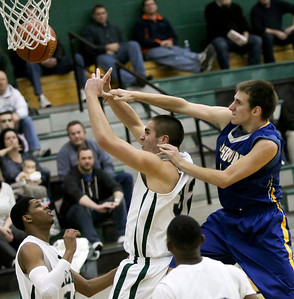 Candace H. Johnson - Shaw Suburban Media Johnsburg's Mike Ward knocks the ball away from Grayslake Central's Casey Boyle in the third quarter during the FVC Fox Division matchup game at Grayslake Central.