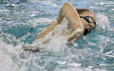 Lauren M. Anderson - landerson@shawmedia.com Jacob's Alex Rienbrecht takes a breath during the 200-yd freestyle race on Thursday during the triangular meet between Huntley, Jacobs/Dundee-Crown and Woodstock North. Rienbrecht finished with a time of 1:52.48.
