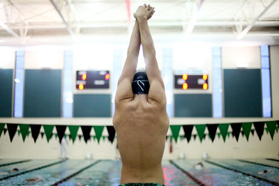 Lauren M. Anderson - landerson@shawmedia.com Woodstock North's Trevor Nomm stretches before getting on the blocks to compete in the 200-yard freestyle on Thursday.
