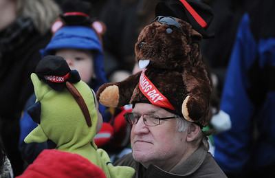 Sarah Nader - snader@shawmedia.com Tom Erlenborn of Bull Valley listens to the prognostication at the annual Groundhog Days festival in Woodstock on February 2, 2012. Woodstock Willie didn't see his shadow, which means an early spring is headed this way.