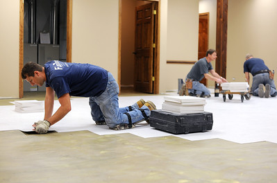 Sarah Nader - snader@shawmedia.com Andrew Hauser of South Elgin puts in the flooring at the new Lake in the Hills Food Pantry located at 1111 Pyott Road on Thursday, February 2, 2012.