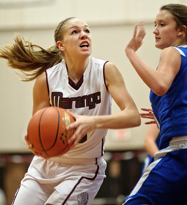 Daniel J. Murphy - dmurphy@shawmedia.com  Marengo forward Jessica Villie (left) slips past Burlington Central forward Alison Colby (right) to score a basket in the first period Friday February 3, 2012 at Marengo high school in Marengo. Marengo defeated Burlington Central 53-33 to clinch a share of BNC East title.