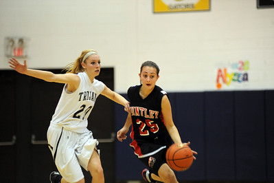 Daniel J. Murphy - dmurphy@shawmedia.com  Huntley guard Alexandra Beaudette (right) sprints past Cary-Grove's Alyssa Lee (left) in the third period Saturday February 4, 2012 at Cary-Grove high school in Cary. Cary-Grove defeated Huntley 41-39.