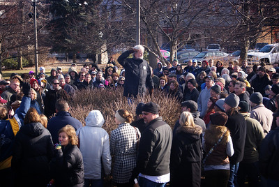 """Yadira Shanchez Olson for The Northwest Herald A crowd of people gather near the gazebo in the Woodstock Square as part of the """"Groundhog Day"""" walking tour on Saturday February 4, 2012 in Woodstock."""