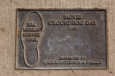 """Yadira Shanchez Olson for The Northwest Herald A plaque marks the exact spot on Cass Street where actor Bill Murray's puddle scene was filmed for the movie """"Groundhog Day"""". The corner was one of 14 tour stops on the """"Groundhog Day"""" walking tour Saturday February 4, 2012 in the Woodstock Square in Woodstock."""