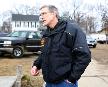 H. Rick Bamman -hbamman@shawmedia.com McHenry Township Fire Protection District Chief Tony Huemann briefs the media Saturday on the recovery efforts.