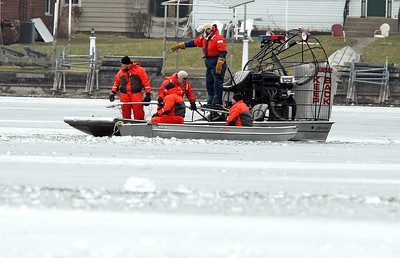 H. Rick Bamman -hbamman@shawmedia.com Ice divers using side sonar prepare to search Pistakee Bay Saturday morning for the body of a missing angler that fell through the ice Friday evening.
