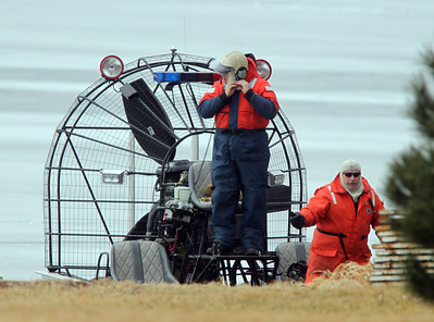 H. Rick Bamman -hbamman@shawmedia.com An air boat operator suits up to continue the search of Pistakee Bay for a missing angler that fell through the ice Friday evening.