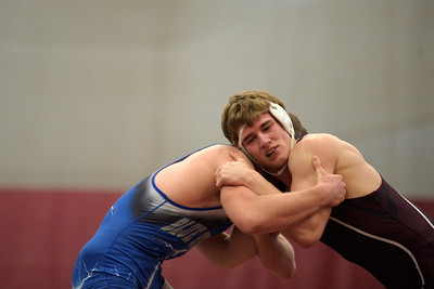 Daniel J. Murphy - dmurphy@shawmedia.com  Woodstock senior Kenny Robson (left) squares off with Marengo senior Mark Hendricks (right) on Saturday February 4, 2012 in the 170-pound championship match of the IHSA 2A Marengo Regional at Marengo High School. Hendricks defeated Robson 12-4.