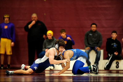 Daniel J. Murphy - dmurphy@shawmedia.com  Vernon Hills' Danny Klema (left) wrestles with Woodstock's Donte Arnold (right) for third place in the 152-pound weight class Saturday February 4, 2012 at Marengo high school in Marengo.