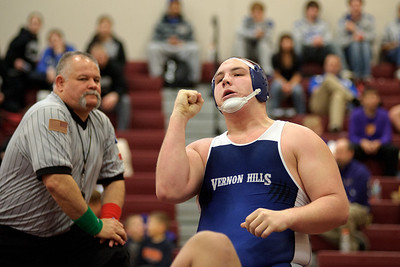 Daniel J. Murphy - dmurphy@shawmedia.com  Vernon Hills' Jeremy Brazil pumps his fist after a quick takedown of Hampshire's Zach Oranger on Saturday February 4, 2012 in the 285-pound championship match of the IHSA 2A Marengo Regional at Marengo High School.