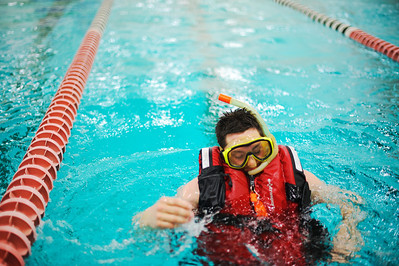Daniel J. Murphy - dmurphy@shawmedia.com  Dan Torkelson of McHenry practices an inert diver rescue tow exercise Sunday February 5, 2012 at McHenry High School in McHenry. Area dive and swift water rescue team members from McHenry and Lake county fire departments were present for training.
