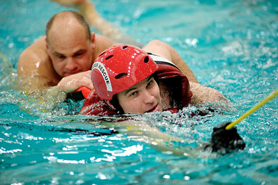 Daniel J. Murphy - dmurphy@shawmedia.com  Part time firefighter Nick Escher (right) of McHenry saves Chris Rohde (left) of McHenry in a swift water training exercise Sunday February 5, 2012 at McHenry High School in McHenry.