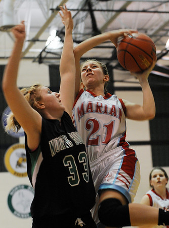 Sarah Nader - snader@shawmedia.com North Boone's Melanie Krawczyk (left) guards Marian Central's Constance Melchionna while she tries to take a shot  during the fourth quarter of Monday's IHSA Class 2A North Boone Regional quarterfinals in Poplar Grove on February 6, 2012. Marian Central lost, 32-48.