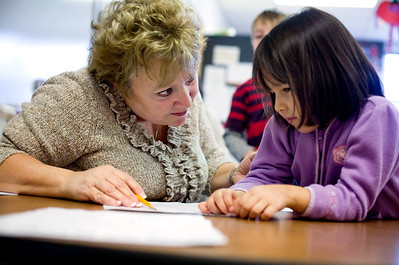 Jenny Kane - jkane@shawmedia.com Karen Fallon helps Daisy Garcia on her reading during class at Alden-Hebron elementary school. Recently Alden-Hebron won an academic improvement award from the Illinois State Board of education.