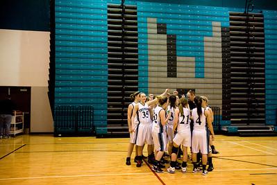 Jenny Kane - jkane@shawmedia.com Woodstock North varsity girls basketball team huddles together after their win against Hampshire.