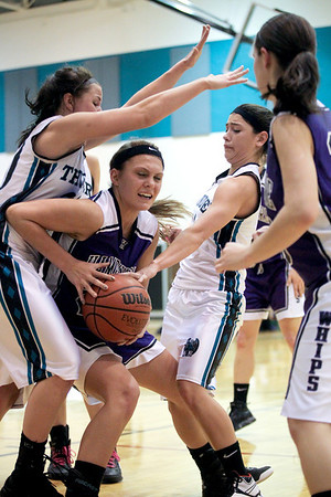 Jenny Kane - jkane@shawmedia.com Hampshire's Elizabeth Panzica tries to break through Woodstock North's defense to make a basket during the second period of their game at Woodstock North.