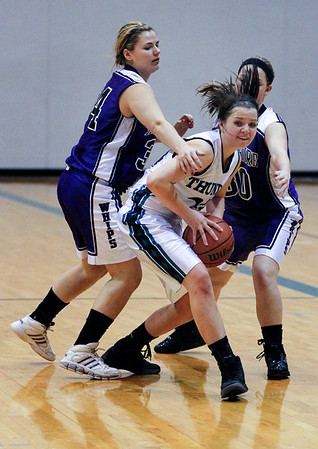 Jenny Kane - jkane@shawmedia.com Woodstock North's Emma Everly looks to pass the ball as Hampshire's Abigaile Burke, (left) and Sara Finn, (right) try to draw a foul during the final minutes of their game at Woodstock North. Woodstock North defeated Hampshire 54-45.