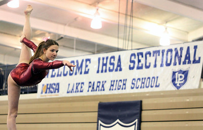 JEFF KRAGE/FOR THE NORTHWEST HERALD Prairie Ridge's Rachael Underwood competes on the balance beam during Tuesday's IHSA sectional at Lake Park High School. Roselle 2/7/12