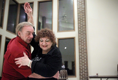 Jenny Kane - jkane@shawmedia.com Frank and Jackie Penze of Cary show how to do a proper ending to a dance during one of their dance classes at Veterans Acre Park. The Penze's have been married for 51 years. They started out learning how to dance for their daughter's wedding and progressed to becoming dance instructors.