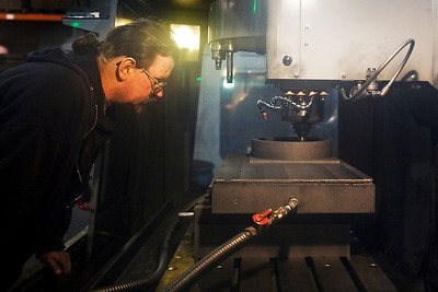 Lance Booth - lbooth@shawmedia.com John Doyle, of Midlothian, is a shop foremon at Aero Industries Inc.,  makes graphite grinding wheels in a CNC Vertical Mill in Harvard on Wednesday, February 8, 2012.