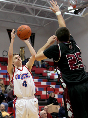 Sarah Nader - snader@shawmedia.com Dundee-Crown's Will Stupar (left) is guarded by Prairie Ridge's Nick Margiotta while he takes a shot during the second quarter of Wednesday's FVC Valley matchup in Carpentersville on February 8, 2012. Dundee-Crown won, 44-29.