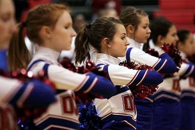Sarah Nader - snader@shawmedia.com Dundee-Crown's cheerleaders listen to the National Anthem during Wednesday's FVC Valley matchup against Prairie Ridge in Carpentersville on February 8, 2012. Dundee-Crown won, 44-29.