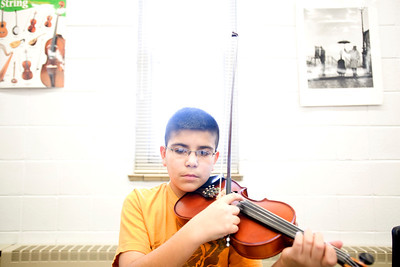Lance Booth - lbooth@shawmedia.com Luis Garcia, 12, of Carpentersville, plays violin in sixth grade orchestra at Lakewood Elementary on Wednesday, February 8, 2012. The elementary school received a grant from the Mr. Holland Opus Music Foundation, which will help purchase instruments.