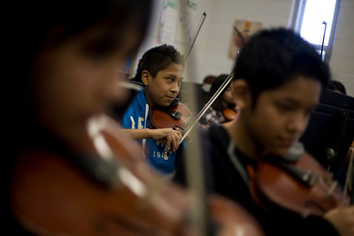 Lance Booth - lbooth@shawmedia.com Eduardo Carrillo, 11, of Carpentersville, plays violin in sixth grade orchestra at Lakewood Elementary on Wednesday, February 8, 2012. The school received a grant from the Mr. Holland Opus Music Foundation and will use the money to help band and orchestra classes.