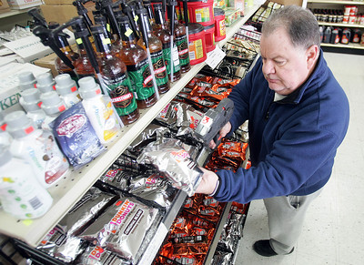 H. Rick Bamman - hbamman@shawmedia.com Fred Thompson, owner of Discount Grocery Outlet prices packages of coffee in the store in East Dundee.