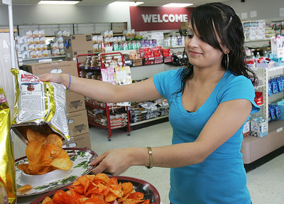 H. Rick Bamman - hbamman@shawmedia.com Estrella Orozco prepares a free sample tray at the Discount Grocery Outlet at 470 Dundee Ave. just north of Santa's Village in East Dundee.