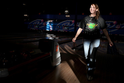 Sarah Nader - snader@shawmedia.com Marengo's Cassy Hogan, 17, is pleased with her score while at bowling practice at Glo-Bowl in Marengo on Wednesday, February 8, 2012. On Friday the team will be traveling to Rockford to compete in their first ever state bowling meet.