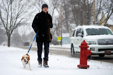 Daniel J. Murphy - dmurphy@shawmedia.com  Matt Vuller of Crystal Lake walks his dog Buddy Friday February 10, 2012 in Cary.