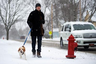 Daniel J. Murphy - dmurphy@shawmedia.com  Matt Vuller of Crystal Lake walks his dog Buddy Friday February 10, 2012 in Cary.