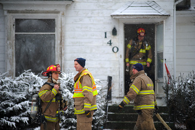 Daniel J. Murphy - dmurphy@shawmedia.com  The Crystal Lake Fire Rescue Department performs a training exercise in an abandoned home on Elmhurst Street Friday February 10, 2012 in Crystal Lake.
