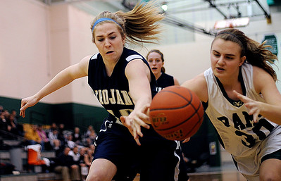 Sarah Nader - snader@shawmedia.com Cary-Grove's Hannah Phillips (left) and Grayslake Central's Michelle Lettenmair try to get control of the ball during the second quarter of Thursday's crossover game between the FVC Valley champion and the FVC Fox Champion on February 9, 2012 in Grayslake. Cary-Grove won, 58-54.