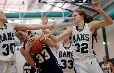 Sarah Nader - snader@shawmedia.com Cary-Grove's Paige Lincicum (33) grabs the rebound during the fourth quarter of Thursday's crossover game between the FVC Valley champion and the FVC Fox champion on February 9, 2012 in Grayslake. Cary-Grove won, 58-54.