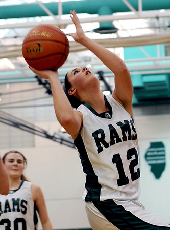 Sarah Nader - snader@shawmedia.com Grayslake Central's Claire Brennan takes a shot during the fourth quarter of Thursday's crossover game between the FVC Valley champion and the FVC Fox champion on February 9, 2012 in Grayslake. Cary-Grove won, 58-54.