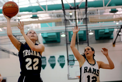 Sarah Nader - snader@shawmedia.com Cary-Grove's Megan Leisten (left) takes a shot during the first quarter of Thursday's crossover game between the FVC Valley champion and the FVC Fox champion on February 9, 2012 in Grayslake. Cary-Grove won, 58-54.