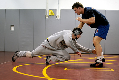 Sarah Nader - snader@shawmedia.com Richmond-Burton's Jack Dechow (right) wrestles his teammate, Brett O'Kane during practice in Richmond on Thursday, February 9, 2012. The Richmond-Burton wrestling team is competing in sectionals this weekend.