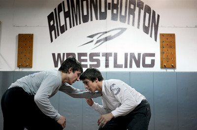 Sarah Nader - snader@shawmedia.com Richmond-Burton's Cameron Kennedy (right) wrestles his teammate, Garrett Sutton during practice in Richmond on Thursday, February 9, 2012. The Richmond-Burton wrestling team is competing in sectionals this weekend.