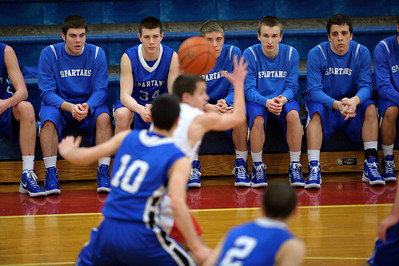 Daniel J. Murphy - dmurphy@shawmedia.com  The St. Francis bench watches Marian Central's Max St. Clair pass the ball in the second period Friday February 10, 2012 at Marian Central High School in Woodstock. St. Francis defeated Marian Central 61-42.