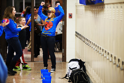 """Daniel J. Murphy - dmurphy@shawmedia.com  Marian Central junior Becca Turski, 16, celebrates after winning a game of """"bozo buckets""""  while wearing alcohol impairment goggles Friday February 10, 2012 at Marian Central High School in Woodstock. The Marian Central club A.T.T.A.C.C. (Adolescents Teaching Teens About Combatting Collisions) sponsored a series of activities to help teens become safer drivers."""