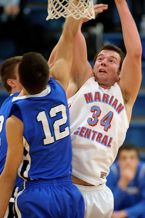 Daniel J. Murphy - dmurphy@shawmedia.com  Marian Central power forward Zach Ricchuito #34 powers to the basket in the second period Friday February 10, 2012 at Marian Central High School in Woodstock. St. Francis defeated Marian Central 61-42.