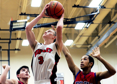 Sarah Nader - snader@shawmedia.com Dundee-Crown's Brandon Rodriguez (right) guards Huntley's Jake Brock while he takes a shot in the fourth quarter of Saturday's game in Huntley on February 11, 2012. Huntley won, 41-40.