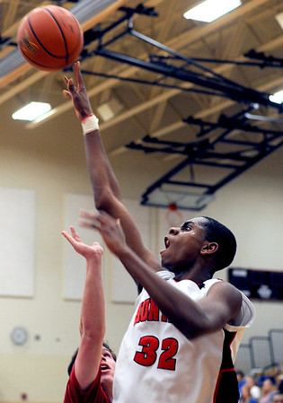 Sarah Nader - snader@shawmedia.com Dundee-Crown's Thomas McNally (left) guards Huntley's Amanze Egekeze while he make a shot during the third quarter of Saturday's game in Huntley on February 11, 2012. Huntley won, 41-40.
