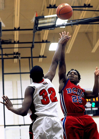 Sarah Nader - snader@shawmedia.com Huntley's Amanze Egekeze (left) jumps to block a shot by Dundee-Crown's Bruce Dantzler during Saturday's game in Huntley on February 11, 2012. Huntley won, 41-40.