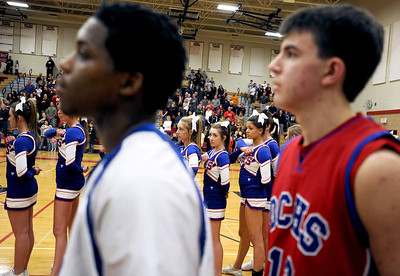 Sarah Nader - snader@shawmedia.com Dundee-Crown players and cheerleaders listen to the National Anthem before Saturday's game against Huntley on February 11, 2012. Huntley won, 41-40.