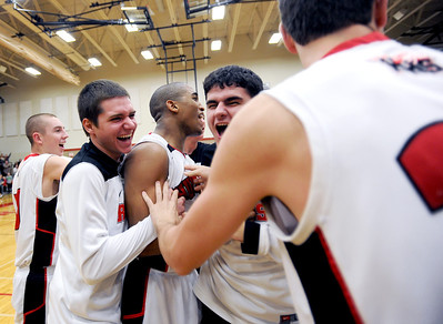 Sarah Nader - snader@shawmedia.com Huntley's Bryce Only (center) celebrates with his teammates after they won Saturday's game against Dundee-Crown on February 11, 2012. Huntley won, 41-40.