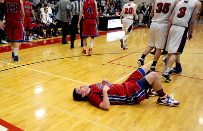 Sarah Nader - snader@shawmedia.com Dundee-Crown's thomas McNally is knocked to the ground during the last minute of play in the fourth quarter of Saturday's game against Huntley on February 11, 2012. Huntley won, 41-40.